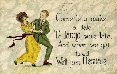 """This card postmarked March 8, 1920. Text (making reference to the popular """"Hesitation Tango""""): Come let's make a date To Tango quite late, And when we get tired We'll just Hesitate.  Copied from Wikipedia and in the public domain because the copyright has expired."""