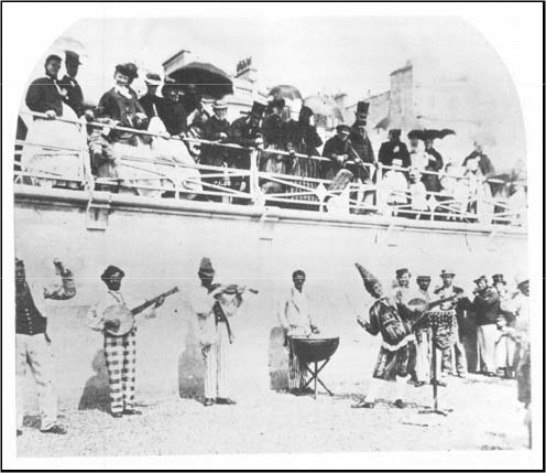 Beach entertainers, including a black minstrel band, on Brighton Beach in the mid 1860s. Taken from The History of Photography in Brighton
