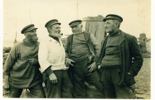 """Reproduction courtesy of Alan Hayes.  """"Spinning A Yarn"""", L to R  Nick Humphrey, Tom Bassett (sail maker) Rolf and Taylor."""