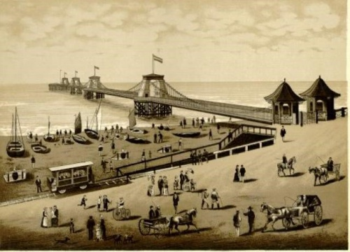 The esplanade was later sold to the aquarium and the entrance to the pier was relocated to where it met the shore as seen above. Two toll-houses were added, and these still survive today as shop kiosks on the Palace (Brighton) Pier. Image reproduced courtesy of The Royal Pavilion and Museums, Brighton & Hove.